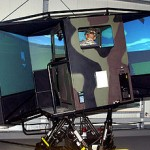 A soldier tests out a heavy-wheeled-vehicle driver simulator. (Image courtesy of the Department of Defense.)